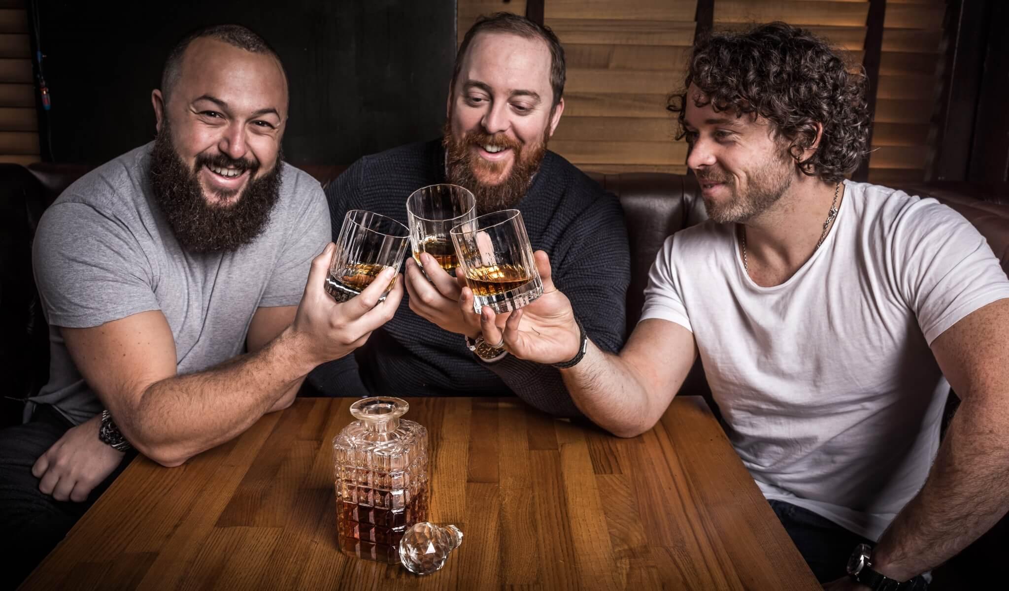 John Ennis, Nick Thomas and Matt Farrell raising a toast